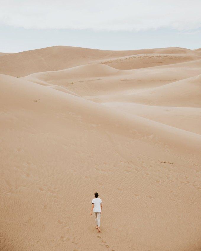 woman on sand dunes